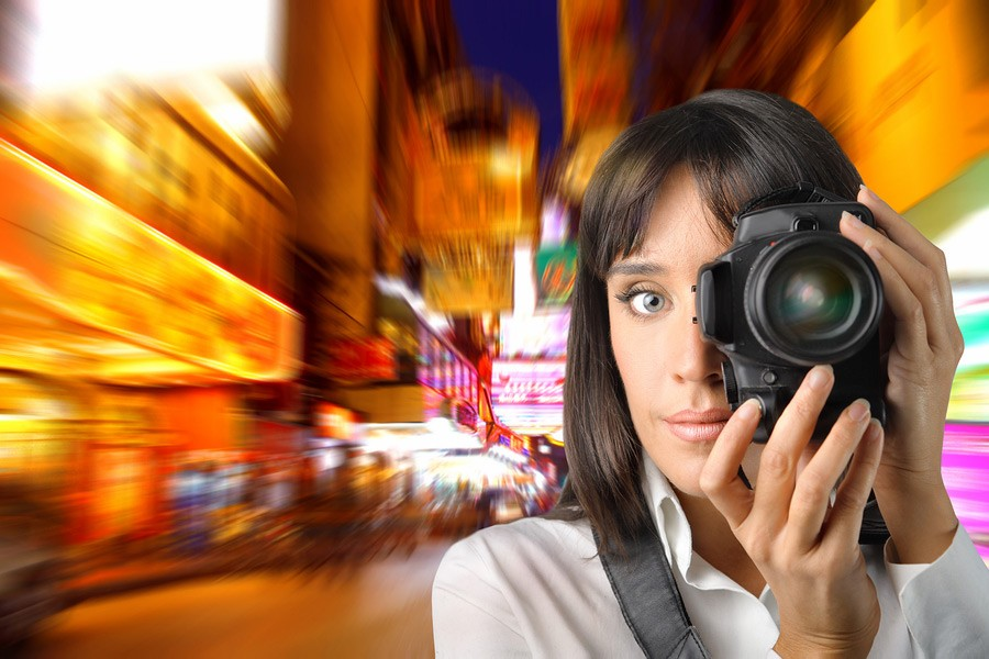 bigstock-Woman-taking-picture-of-modern-900-600-12155660